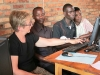 Celeste training students on computer